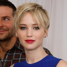 Jennifer Lawrence Debuts the Ultimate Cool-Girl Pixie Style: After Jennifer Lawrence proved she could style her of-the-moment pixie cut in 10 different ways during the Hunger Games: Catching Fire tour, she's done it again, taking on a new look: the mussed-up middle part.