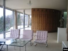 Villa Tugendhat in Brno (Czech Republic) created in 1929-1930 by Ludwig Mies van der Rohe crucifrom chrome plated columns floor to ceiling glass curved makassar wood wall linoleum flooring furniture grouping define space