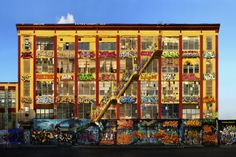 For more than 20 years, graffiti artists were free to spray paint the outside walls of a drab warehouse in Long Island City. 5Pointz became an international graffiti landmark, but in November 2013, the building's owner Jerry Wolkoff ordered the warehouse to be whitewashed.  Image: Graffiti Building by John McGregor