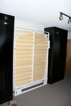 PAX sliding door wardrobe with a hidden Murphy bed.  http://www.ikeahackers.net/2013/03/pax-murphy-bed-with-sliding-doors.html