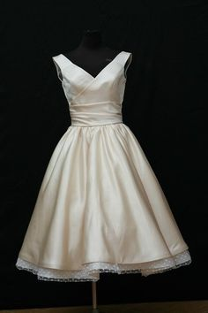 Cute idea - 60s style wedding dress - this one is ~$600.  Dolly Couture makes custom wedding gowns