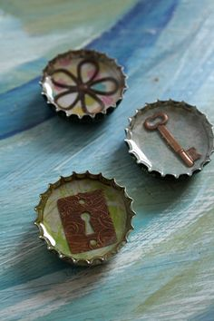 bottle cap art. . i would drill a hole in these and make them into pendants