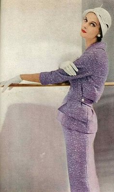 Anne St. Marie wearing a tweed suit by Monte-Sano and Pruzan, straw cloche by Metmar. Photo by Roger Prigent for Vogue 1955.