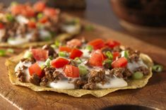 Crunch on these Tostadas with Queso Blanco! Crispy taco shells topped with beef, cheese, tomatoes and more—Tostadas with Queso Blanco are delicious. Kraft Recipes, Kraft Foods, Mexican Dishes, Mexican Food Recipes, Beef Recipes, Cooking Recipes, What's Cooking, Quick Recipes, Velveeta Recipes