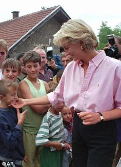 August 10, 1997: Princess Diana comforts the relative of a person killed by a landmine in Sarajevo, Bosnia.