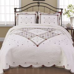 Pretty quilt for a country style bedroom. Click to shop the look!