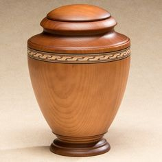 The Gallantry Wood Cremation Urn is a premium wooden urn in traditional vase shape, crafted in a small Spanish town with local hardwoods.
