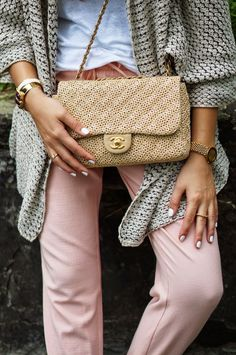 Woven Chanel bag + Pink Pants + White Nails + Gold Jewelry + White T-shirt + Grey Knit Sweater