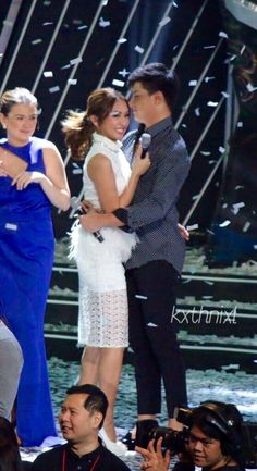 This is Kathryn Bernardo and Daniel Padilla having fun during the grand finale during the 2015 ABS-CBN Christmas Special held last December 8, 2015 at the Smart Araneta Coliseum. Daniel was wearing a black dress shirt with white small dots, black wash skinny jeans, and black shoes; while Kathryn was wearing a white dress and white high-heeled peep-toe platform pumps (which are the Christian Louboutin Lady Peep in white).