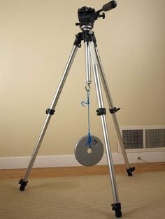 A heavier tripod is a better tripod. But, instead of carrying around a heavy tripod, simply add a weight-bearing hook to the one you have.
