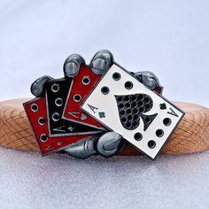 Hand Holding Four Flush Aces Card Poker Casino Play Belt Buckle. $19.95, via Etsy.