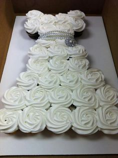 Bridal Cupcakes - elegant & not too tedious! Silver liners, white cake, vanilla buttercream, crystal sprinkles, and strand of pearls on tissue paper covered cake board.