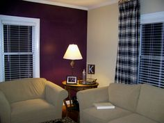 For the master bedroom: ivory linen'd bed against a deep purple accent wall, other walls light cream.