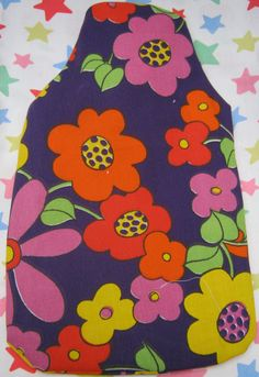 hand made hot water bottle and cover made from 1960s vintage fabric. £6.99, via Etsy.