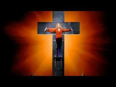 This gorgeous masterpiece was performed 16 years later on the Confessions Tour as it's Madonna's most confessional song. First we hear tales of 3 dancers about how they survived tough times and how they ended up dancing professionally. Then, with some organ music, the most talked about moment of the show arrives: a mirrored cross emerges from be...