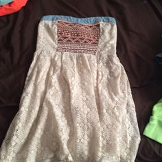 Short strapless dress White laced dress with a denim band around the top purchased from buckle. Dresses Strapless