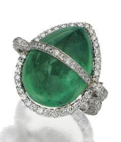 CABOCHON EMERALD AND DIAMOND RING, SIFEN CHANG Set with a pear-shaped cabochon emerald weighing 22.61 carats, held within a ribbon-like setting pavé-set with numerous small round diamonds weighing approximately 2.00 carats, in 18  karat white gold, size 6, signed with Chinese characters for Sifen.