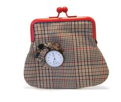 Kiss Clasp Coin Purse Clock Brooch Reclaimed Tweed Fabric Lucky Coin. £17.50, via Etsy.