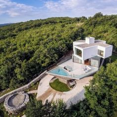 Turato Architects raises Gumno House  above the forest canopy of a Croatian island