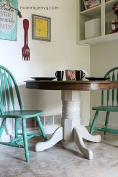 Chalk paint gives this round kitchen table an updated look. I love the teal chairs too!