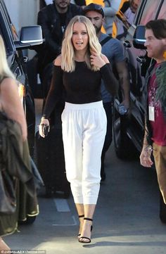 Stepping out: The mother-of-two looked fab in a long-sleeved black top and high-waist whit...