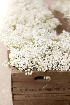Pretty flowers bunches in a wooden crate