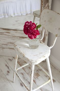 white painted  chair and flowers