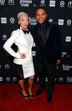 Keyshia Cole, in her very stylish and feminine version of the black and white tuxedo, and Anthony Anderson, in all black, looked sharp on the red carpet at the 2012 UNICEF Evening With The Stars event.