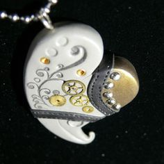 love the steampunk elements with a flourish  Polymer Clay Heart Pendant   One of a Kind MixMedia by SheGeekOnline