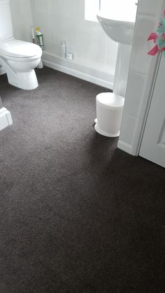 Twist pile- Dark Grey 50oz fitted in a customers shower room, luxury underfoot!.
