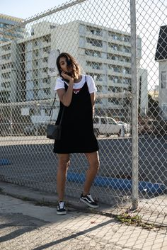 Storm wears Vans old Skool in black with velvet dress and print t-shirt in a minimalistic way los angeles theadorabletwo