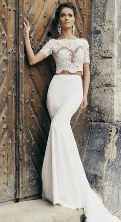 - Two pieces - Lace applique top - Bateau neckline - Satin mermaid skirt with bow detail near zipper All of our gowns are custom made to fit each individual bride. When ordering your gown, please emai