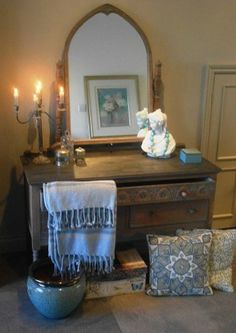 A vintage oak dressing table, gently washed to bring out the carved detail. it has a slightly 'Gothic' feel to it.