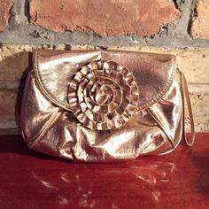 Loeffler Randall Metallic Gold Clutch with Flower This gorgeous is the perfect bit of glitz for a night on the town. Embellished with a flower it's a closet must have. Loeffler Randall Bags Clutches & Wristlets