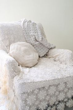 lace covered chair - just threw a lace curtain over one of my fat living room green chairs and it looks awesome.