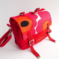 Practical and beautiful messenger bag & bike bag with a unique Marimekko flavor! The flap of this military style bag is customized with the classic...