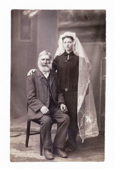 Old Wedding Photo Edwardian.  Poor women often wore their best dress with a veil or headpiece.  This bride appears to be in mourning.