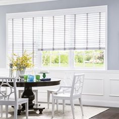 Wood or faux wood blinds w cloth tapes maybe in soft grey.