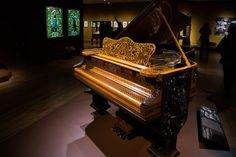 """A piano designed by American cabinetmaker, George A. Schastey, (1839-1894), with inner workings by Steinway & Sons. On display as a part of the new exhibit, at the Metropolitan Museum of Art, NYC, """"Artistic Furniture of the Gilded Age."""" Located in the American Wing. ~ {cwlyons} ~ (Article/image: The New York Times - photo: Pablo Enriquez)"""