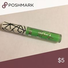 Green Glow in the Dark Lipgloss Green glow in the dark lipgloss. New with tags. Comes with green drawstring bag and large green sunglasses. Beauty Treats Makeup Lip Balm & Gloss