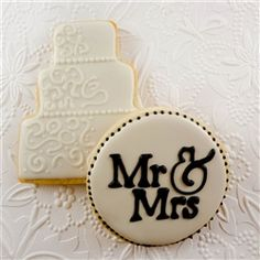 """Wedding Cake Iced Cookie Favors almond sugar cookie favors are baked fresh and hand decorated for your special occasion. Each favor comes with one celebration 3-tier cake and one round Mr. & Mrs. cookie. Contact us for purchase of each design individually. Each cookie is approximately 4-5"""" tall, depending on cookie shape or design. All cookie favors come individually shrink wrapped with the option to upgrade to a satin bow"""