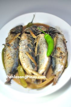 Ginataang Galunggong | medium round scad (galunggong), cleaned and salted 4 pieces Serrano peppers 3 cups coconut milk 1 knob ginger, sliced into strips 1 tablespoon fish sauce 1/2 teaspoon ground black pepper 1 small red onion, sliced 2 cloves crushed garlic