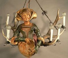 carved lusterweibchen with blazon and costume