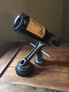 Hand made hot rod wine bottle holder using repurposed engine/car parts.