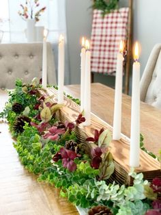 I don't know about you, but every holiday I start to plan out my holiday centerpiece. I'm normally hosting Thanksgiving and Christmas, and with that times two tables a holiday, it can get pricey. So when I saw this, I had to recreate it. We took it to another level and decided to burn the wood. This is a perfect centerpiece that won't break the bank. You can change out the greenery for the holiday season. Supplies Long Stick CandlesPencilSimi-Gloss Lacquer Spray Supplies 4x4… Pumpkin Centerpieces, Holiday Centerpieces, Table Centerpieces, Christmas Decorations, Faux Wood Garage Door, Halloween Bath Bombs, Simple Bed Frame, Painting Tile Floors, Fabric Bowls