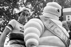 Eddy Merckx joins Bibendum on the podium of the 1975 Tour de France. The Michel Ginfray photograph appeared in The Guardian's look back at the first 100 editions.