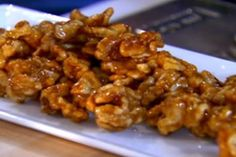 Get Ellie Krieger's Maple Glazed Walnuts Recipe from Food Network