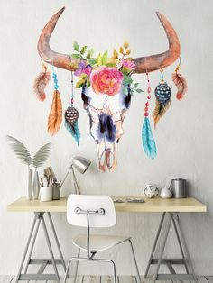 Crazy cool! This chic cow skull decor will add color and class to your walls! - 1 cutout decal of a bull cow skull with flowers and feathers - Available in 3 sizes - So easy to install – just peel and