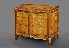 A Russian Neoclassical Rosewood, Sycamore, Fruitwood and Mother-of-Pearl Marquetry and Gilt-Bronze Mounted Commode  St Petersburg, Circa 1775