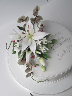 A spray of sugar flowers containing some wired red beads for a Ruby Wedding anniversary cake
